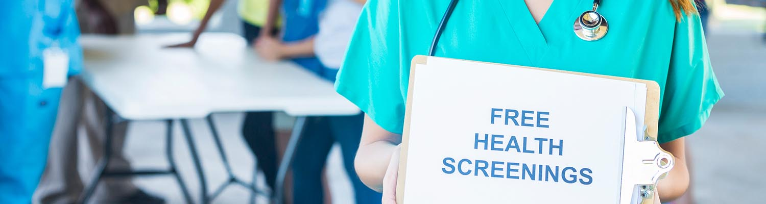 closeup of nurse with stethoscope holding a clipboard that says free health screenings