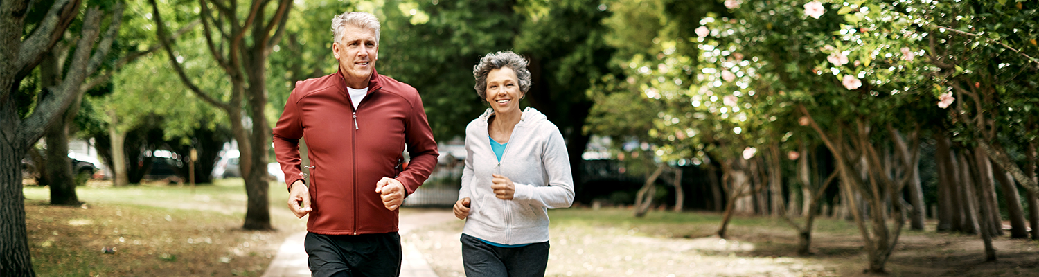 older couple jogging in park