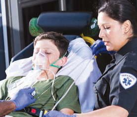 ems worker with young patient