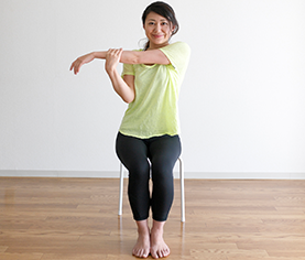 woman sitting in chair and exercising